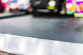 Macro closeup of grocery store checkout aisle conveyor belt
