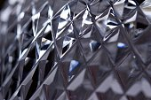This abstract background features an artistic defocused macro view of beautiful hand cut lead crystal facets