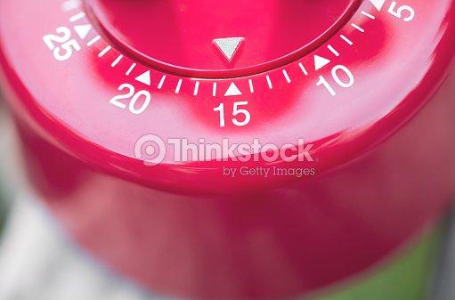 macro of a kitchen egg timer 15 minutes stock photo thinkstock