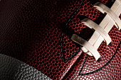 Macro of an american football ball with visible laces, stitches and pigskin pattern