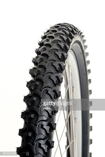 Macro of mountain bike tire on a pure white background