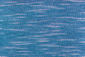Macro close up on blue polyester cotton weave
