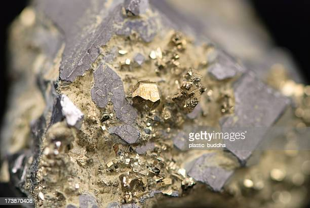 Macro picture of a raw golden nugget found on a mine