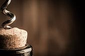 Macro shot of bottle of wine with corkscrew