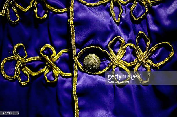 A macro view of the Queen's jockey silks during Royal Ascot 2015 at Ascot racecourse on June 17 2015 in Ascot England