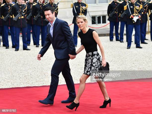 Macron's stepdaughter Tiphaine Auziere and her husband Antoine Choteau arrive at the Elysee Palace prior to the handover ceremony for New French...