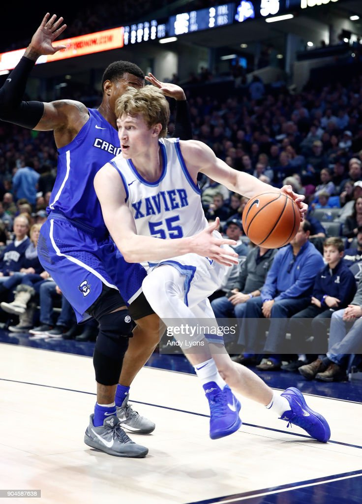 J.P. Macura #55 of the Xavier Musketeers dribbles the ball against the Creighton Bluejays at Cintas Center on January 13, 2018 in Cincinnati, Ohio.