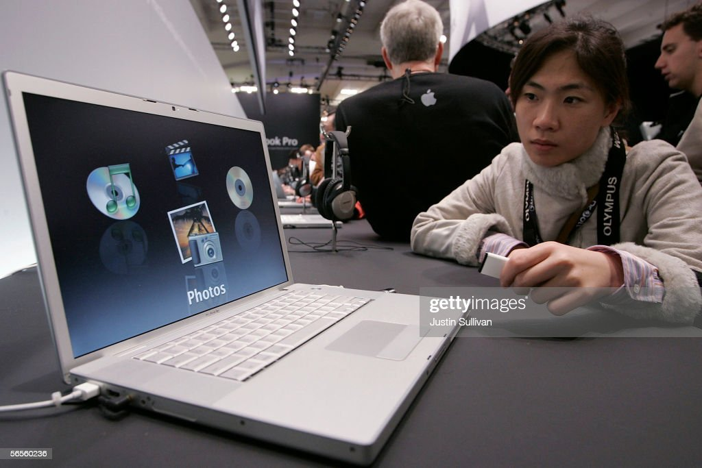 A Macworld attendee looks at a new MacBook Pro laptop with Intel Core Duo processor during the 2006 Macworld January 10, 2006 in San Francisco, California. Jobs announced a new iMac with Intel Core Duo processor as well as the new MacBook Pro laptop.