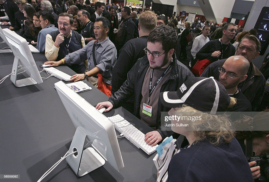 Macworld attendees look at the new iMac with Intel Core Duo processor on display at the 2006 Macworld January 10, 2006 in San Francisco, California. Jobs announced a new iMac with Intel Core Duo processor as well as the new MacBook Pro laptop.