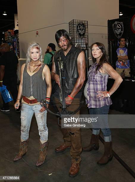 Macy Rose of California dressed as the character Beth Greene Ben Layton of Utah dressed as the character Daryl Dixon and Tara Layton of Utah dressed...