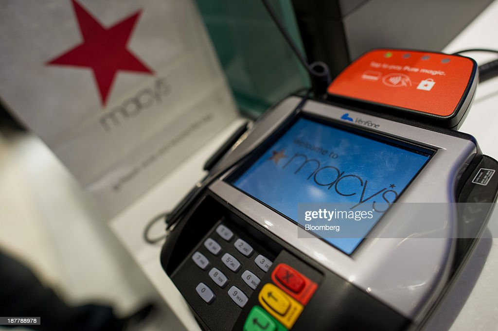 Macy's Inc. signage is seen on a credit card machine at the company's flagship store in New York, U.S., on Tuesday, Nov. 12, 2013. Macy's Inc. is scheduled to release earnings figures on Nov. 13. Photographer: Ron Antonelli/Bloomberg via Getty Images
