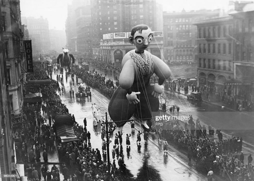 An Eddie Cantor balloon in the Macy's Thanksgiving Day Parade on Broadway New York 29th November 1934