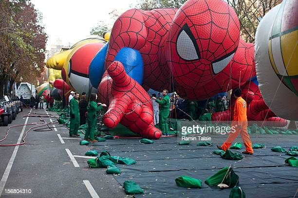 Macy's Thanksgiving Day Parade staff inflate balloons in Manhattan's Upper West Side on November 21 2012 in New York City The 86th annual event is...