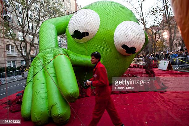 Macy's Thanksgiving Day Parade staff inflate the Kermit the Frog balloon in Manhattan's Upper West Side on November 21 2012 in New York City The 86th...