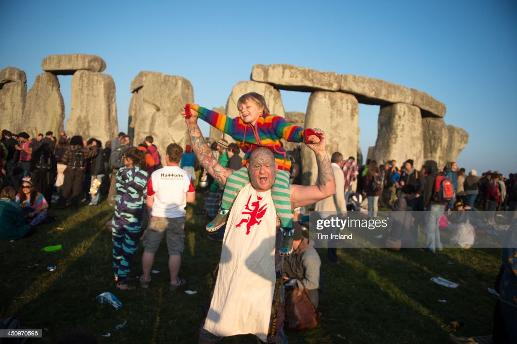 Mad Al and his grandson take part in the summer solstice dawn celebrations after druids, pagans and revellers gathered for the Summer Solstice sunrise at Stonehenge on June 21, 2014 in Wiltshire, England. A sunny forecast brought thousands of revellers to the 5,000 year old stone circle in Wiltshire to see the sunrise on the Summer Solstice dawn. The solstice sunrise marks the longest day of the year in the Northern Hemisphere.