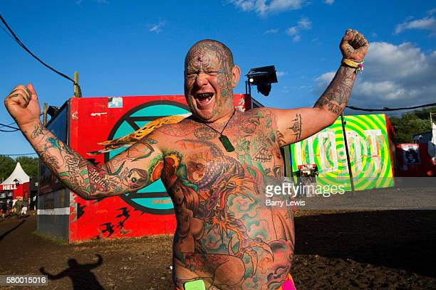 Mad Al covered in tattoos in the Shangri La field Glastonbury Festival 2016 The Glastonbury Festival is the largest greenfield festival in the world...