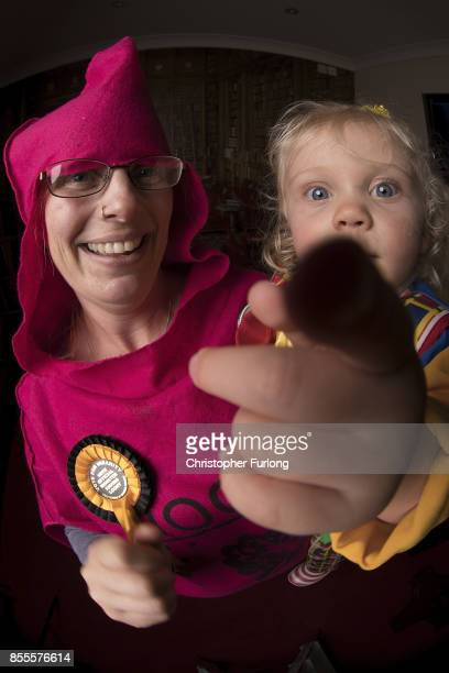 Mad Cow Sarah Howard and her daughter Baby Cakes Emmeline Johnson aged 20 months of The Monster Raving Loony Party pose for a portrait during their...