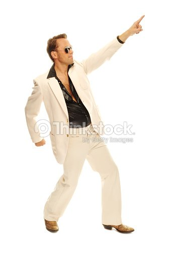 Mad disco dancer in white suit and snake leather boots : Stock Photo
