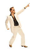 Mad disco dancer in white suit and snake leather boots