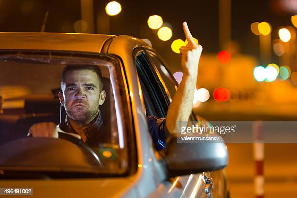 Mad driver showing the finger