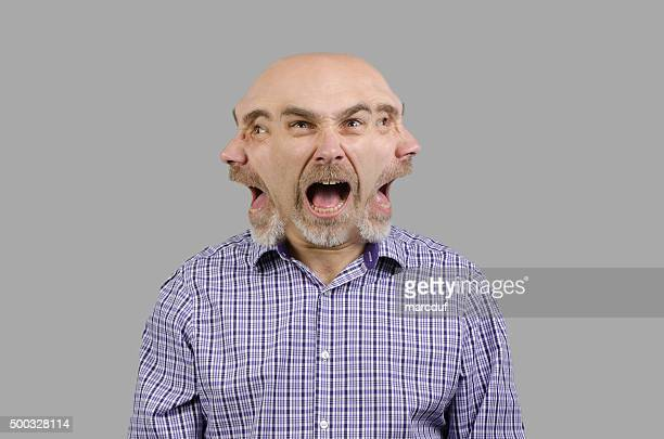 Mad man with three faces shouts on each side.