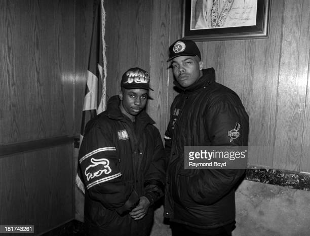Mad Mike and rapper Paris pose for photos at the Final Call Bookstore in Chicago Illinois in JANUARY 1991