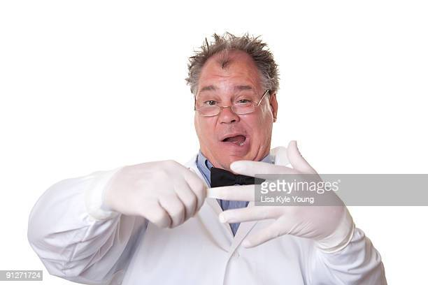 Mad Scientist putting on rubber gloves