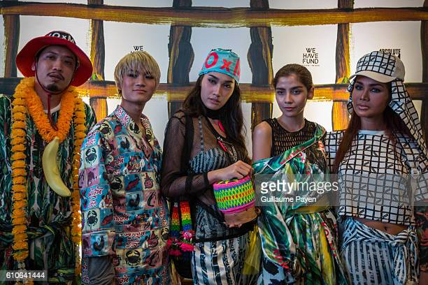 Madaew Pichet Atilattana and his models pose for a picture during the KOxMA project an exclusive collaboration between him knows as well as Thai Baan...