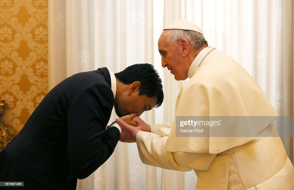 Madagascan Transitional Leader <a gi-track='captionPersonalityLinkClicked' href=/galleries/search?phrase=Andry+Rajoelina&family=editorial&specificpeople=4758126 ng-click='$event.stopPropagation()'>Andry Rajoelina</a> meets with <a gi-track='captionPersonalityLinkClicked' href=/galleries/search?phrase=Pope+Francis&family=editorial&specificpeople=2499404 ng-click='$event.stopPropagation()'>Pope Francis</a> at his private library on April 26, 2013 in Vatican City, Vatican.