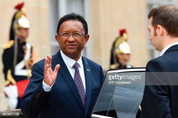 Madagascar President Hery Rajaonarimampianina waves towards his French counterpart as he leaves following their meeting at the Elysee palace on June...
