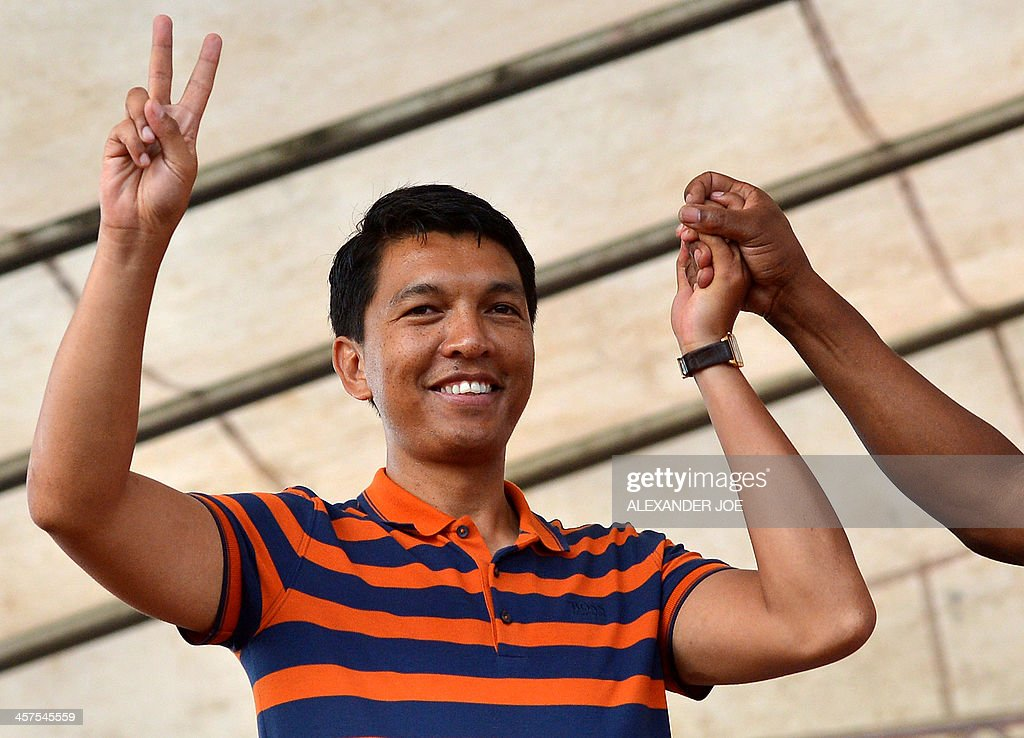 Madagascar strongman <a gi-track='captionPersonalityLinkClicked' href=/galleries/search?phrase=Andry+Rajoelina&family=editorial&specificpeople=4758126 ng-click='$event.stopPropagation()'>Andry Rajoelina</a> gestures during a political rally on December 18, 2013 in Antananarivo ahead of the upcoming presidential election on December 20. On December 20 voters are expected to choose a new president since President <a gi-track='captionPersonalityLinkClicked' href=/galleries/search?phrase=Andry+Rajoelina&family=editorial&specificpeople=4758126 ng-click='$event.stopPropagation()'>Andry Rajoelina</a> seized power in a 2009 coup, with many hoping it will put an end to years of political turmoil.