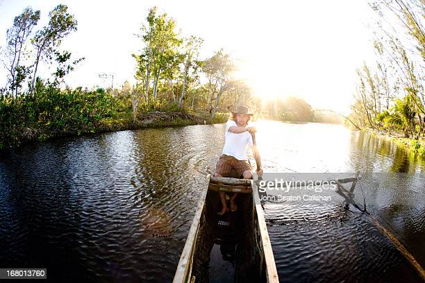 Madagascar, Toamasina, man paddling pirogue.