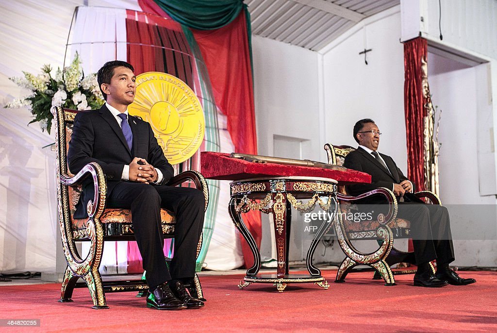 Madagascar's newly elected President <a gi-track='captionPersonalityLinkClicked' href=/galleries/search?phrase=Hery+Rajaonarimampianina&family=editorial&specificpeople=11519052 ng-click='$event.stopPropagation()'>Hery Rajaonarimampianina</a> (R) and outgoing president <a gi-track='captionPersonalityLinkClicked' href=/galleries/search?phrase=Andry+Rajoelina&family=editorial&specificpeople=4758126 ng-click='$event.stopPropagation()'>Andry Rajoelina</a> (L) attend a presidential handover ceremony at Iavoloha Presidential Palace in Antananarivo on January 24, 2014. Rajoelina stood down, symbolically handing over power ahead of his elected successor's inauguration, a move designed to steer the Indian Ocean island out of crisis.