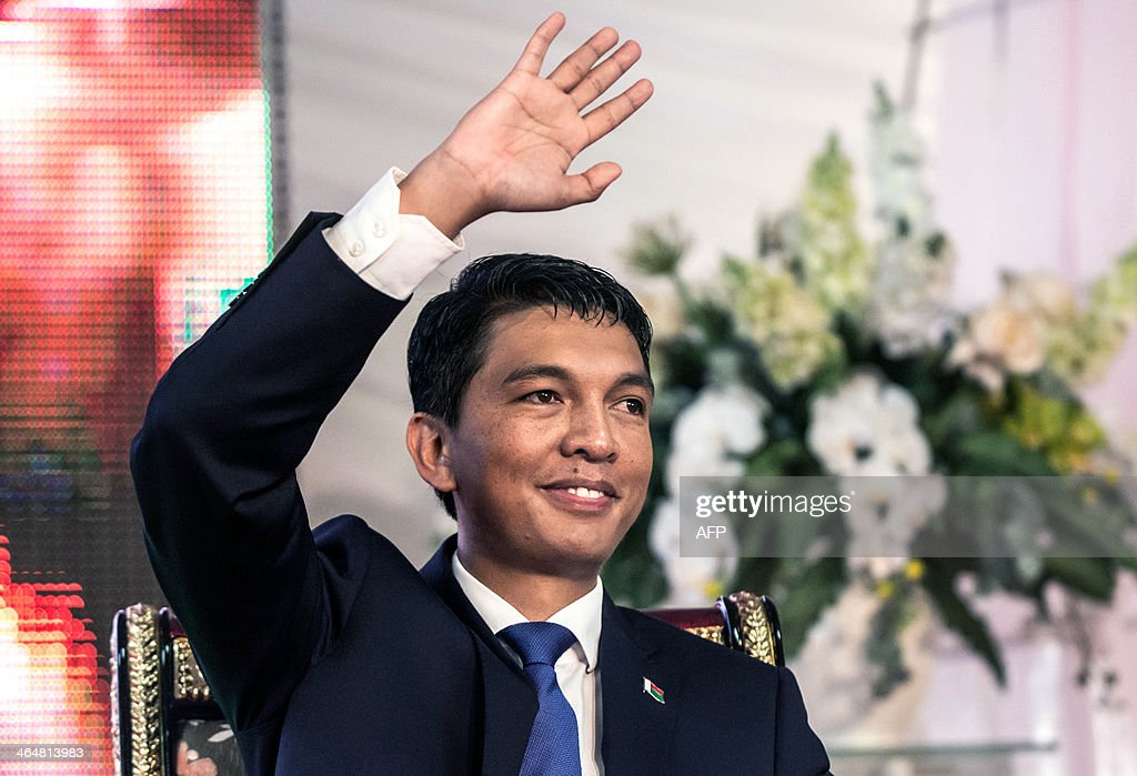 Madagascar's outgoing president <a gi-track='captionPersonalityLinkClicked' href=/galleries/search?phrase=Andry+Rajoelina&family=editorial&specificpeople=4758126 ng-click='$event.stopPropagation()'>Andry Rajoelina</a> greets the crowds during a presidential handover ceremony at Iavoloha Presidential Palace in Antananarivo on January 24, 2014. Rajoelina stood down, symbolically handing over power ahead of his elected successor's inauguration, a move designed to steer the Indian Ocean island out of crisis.