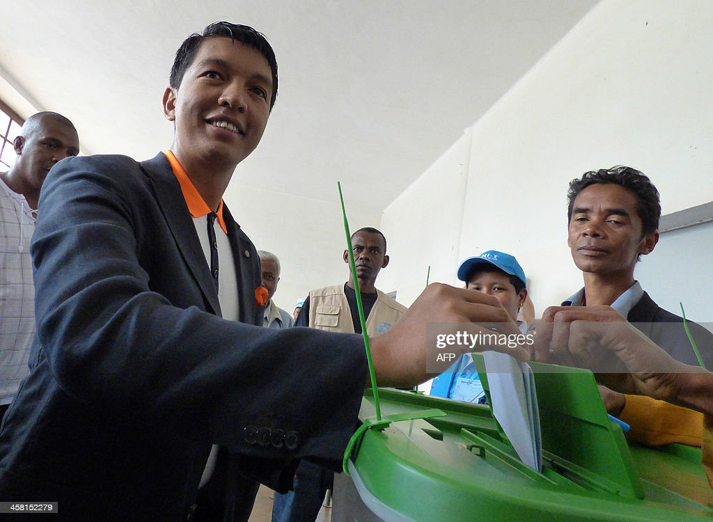 Madagascar's President <a gi-track='captionPersonalityLinkClicked' href=/galleries/search?phrase=Andry+Rajoelina&family=editorial&specificpeople=4758126 ng-click='$event.stopPropagation()'>Andry Rajoelina</a> casts his ballot in a polling station during the presidential election on December 20, 2013 in Antananarivo, Madagascar. Madagascans return to polling stations on Friday to choose a new president in a run-off vote aimed at ending a political and economic crisis sparked by a coup four years ago.