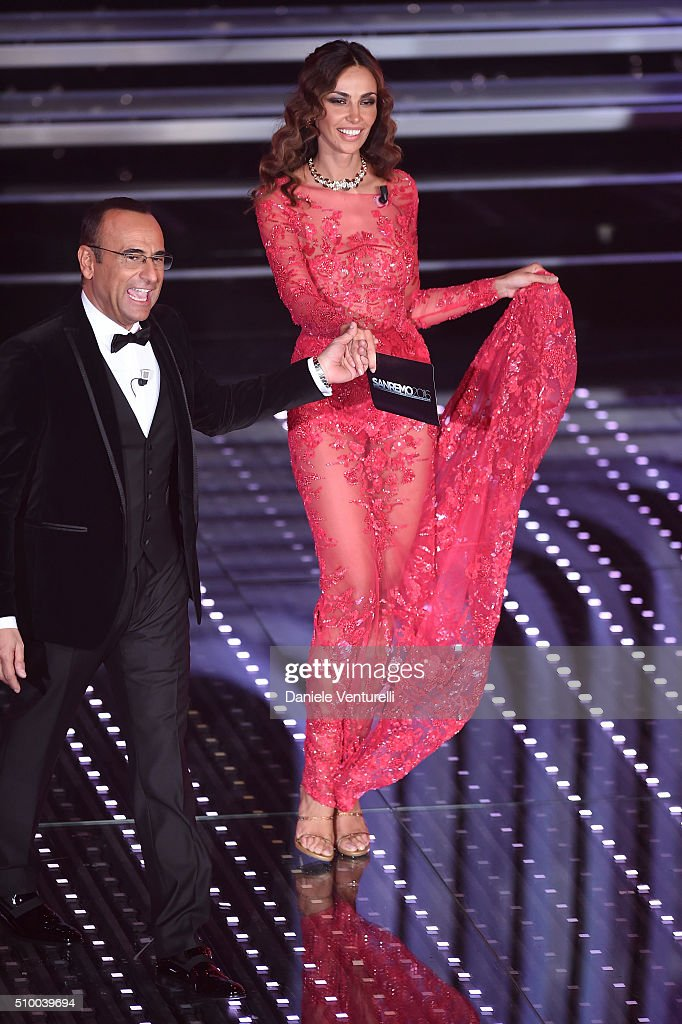 Madalina Ghenea and <a gi-track='captionPersonalityLinkClicked' href=/galleries/search?phrase=Carlo+Conti&family=editorial&specificpeople=4496663 ng-click='$event.stopPropagation()'>Carlo Conti</a> attend the closing night of 66th Festival di Sanremo 2016 at Teatro Ariston on February 13, 2016 in Sanremo, Italy.