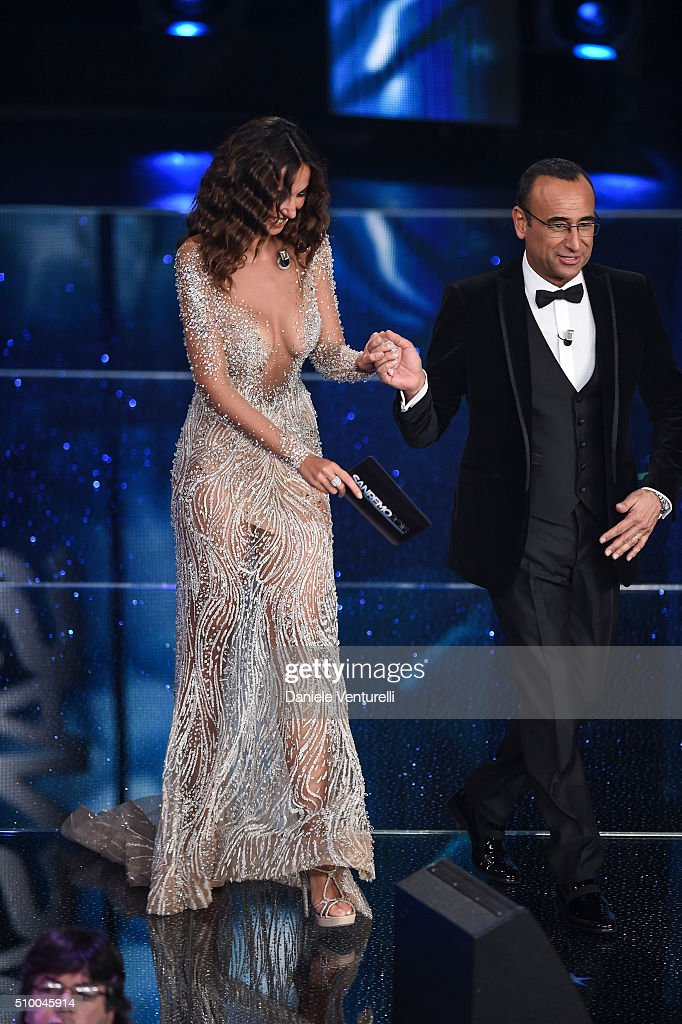 Madalina Ghenea and <a gi-track='captionPersonalityLinkClicked' href=/galleries/search?phrase=Carlo+Conti&family=editorial&specificpeople=4496663 ng-click='$event.stopPropagation()'>Carlo Conti</a> attend the closing night of 66th Festival di Sanremo 2016 at Teatro Ariston on February 13, 2016 in Sanremo, Italy.