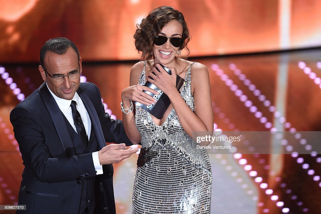 Madalina Ghenea and <a gi-track='captionPersonalityLinkClicked' href=/galleries/search?phrase=Carlo+Conti&family=editorial&specificpeople=4496663 ng-click='$event.stopPropagation()'>Carlo Conti</a> attend the fourth night of the 66th Festival di Sanremo 2016 at Teatro Ariston on February 12, 2016 in Sanremo, Italy.