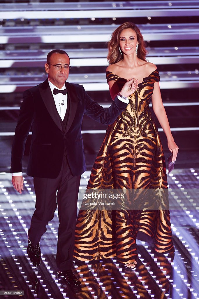 Madalina Ghenea and <a gi-track='captionPersonalityLinkClicked' href=/galleries/search?phrase=Carlo+Conti&family=editorial&specificpeople=4496663 ng-click='$event.stopPropagation()'>Carlo Conti</a> attend the opening night of the 66th Festival di Sanremo 2016 at Teatro Ariston on February 9, 2016 in Sanremo, Italy.