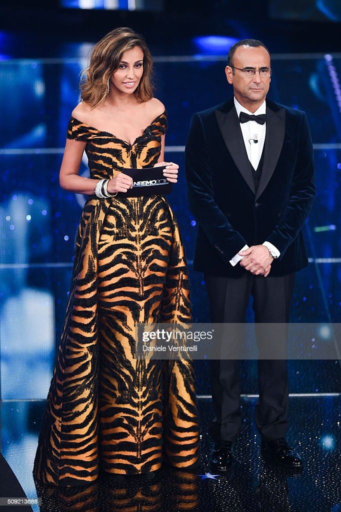 Madalina Ghenea and Carlo Conti attend the opening night of the 66th Festival di Sanremo 2016 at Teatro Ariston on February 9, 2016 in Sanremo, Italy.
