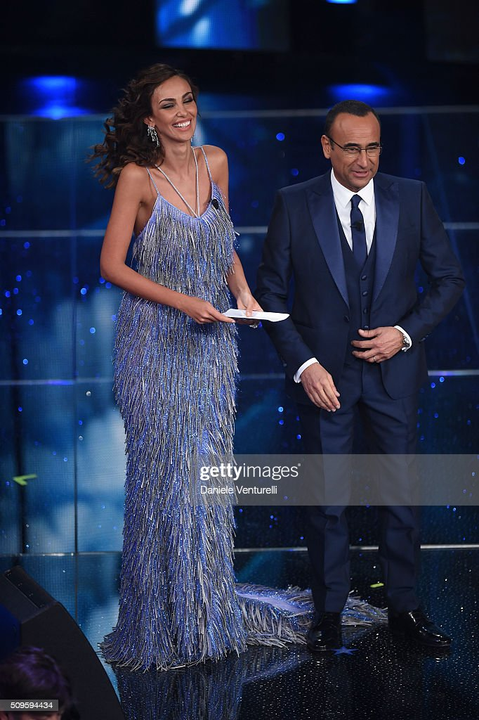 Madalina Ghenea and <a gi-track='captionPersonalityLinkClicked' href=/galleries/search?phrase=Carlo+Conti&family=editorial&specificpeople=4496663 ng-click='$event.stopPropagation()'>Carlo Conti</a> attend the third night of the 66th Festival di Sanremo 2016 at Teatro Ariston on February 11, 2016 in Sanremo, Italy.