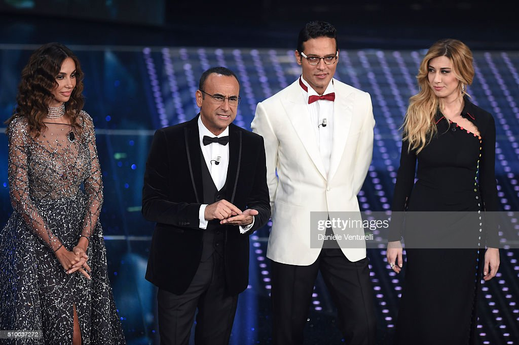 Madalina Ghenea, Carlo Conti, Gabriel Garko and Virginia Raffaele attend the closing night of 66th Festival di Sanremo 2016 at Teatro Ariston on February 13, 2016 in Sanremo, Italy.