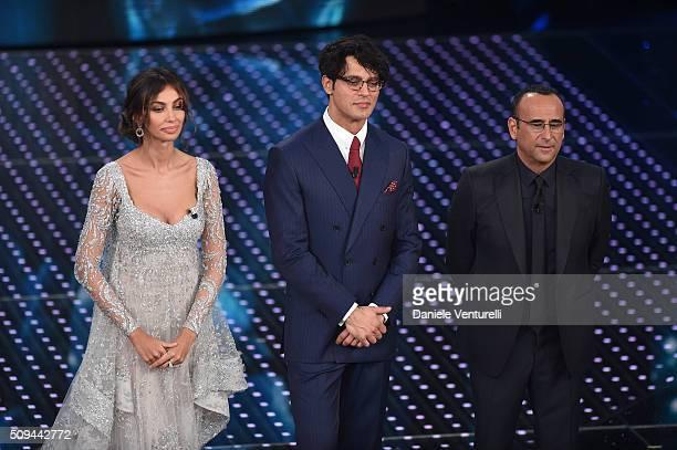 Madalina Ghenea Gabriel Garko and Carlo attend second night of the 66th Festival di Sanremo 2016 at Teatro Ariston on February 10 2016 in Sanremo...