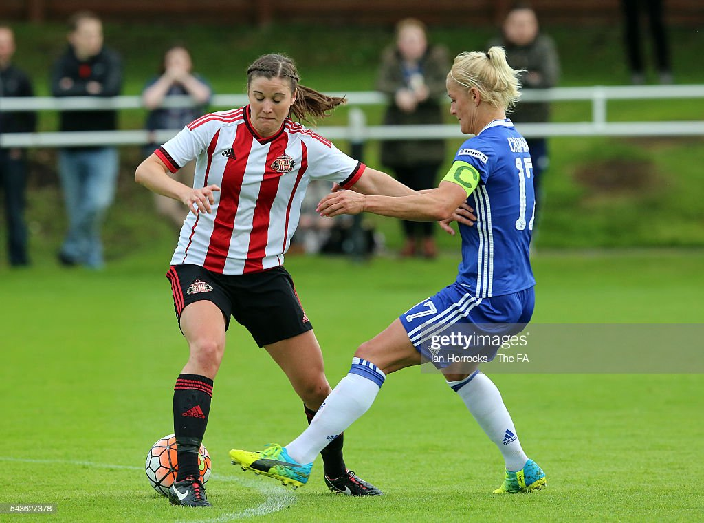 Madaline Hill of Sunderland (L) is tackled by Katie Chapman of Chelsea during the WSL 1 League match between Sunderland Ladies and Chelsea Ladies FC at the Hetton Center on June 29, 2016 in Hetton, England.