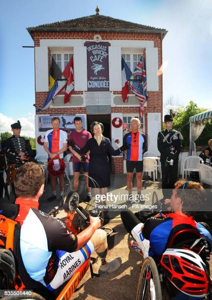 Madame Arlett Gondree owner of the the Cafe Gondree at Pegasus Bridge Normandy addresses the Band of Brothers bike ride cyclists fundraising for Help...