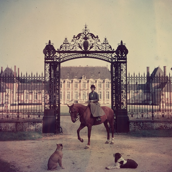 Madame de la HayeJousselin on her horse at the gates to her chateau in Normandy