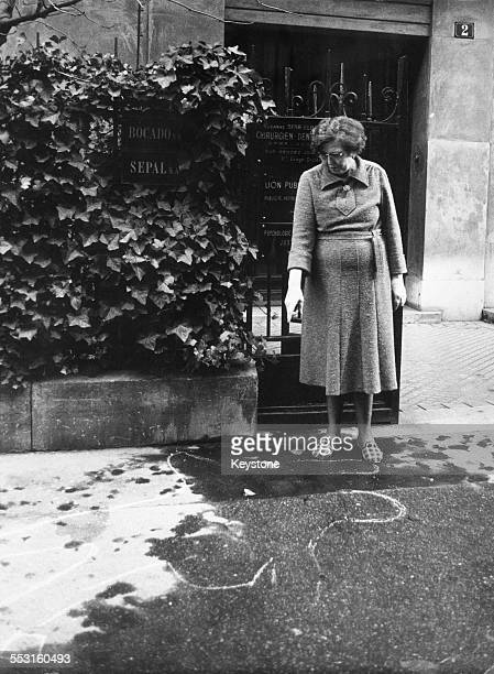 Madame Favier the caretaker of the apartment building at 2 Rue des Dardanelles in Paris points to the chalk outline marking the position of the body...