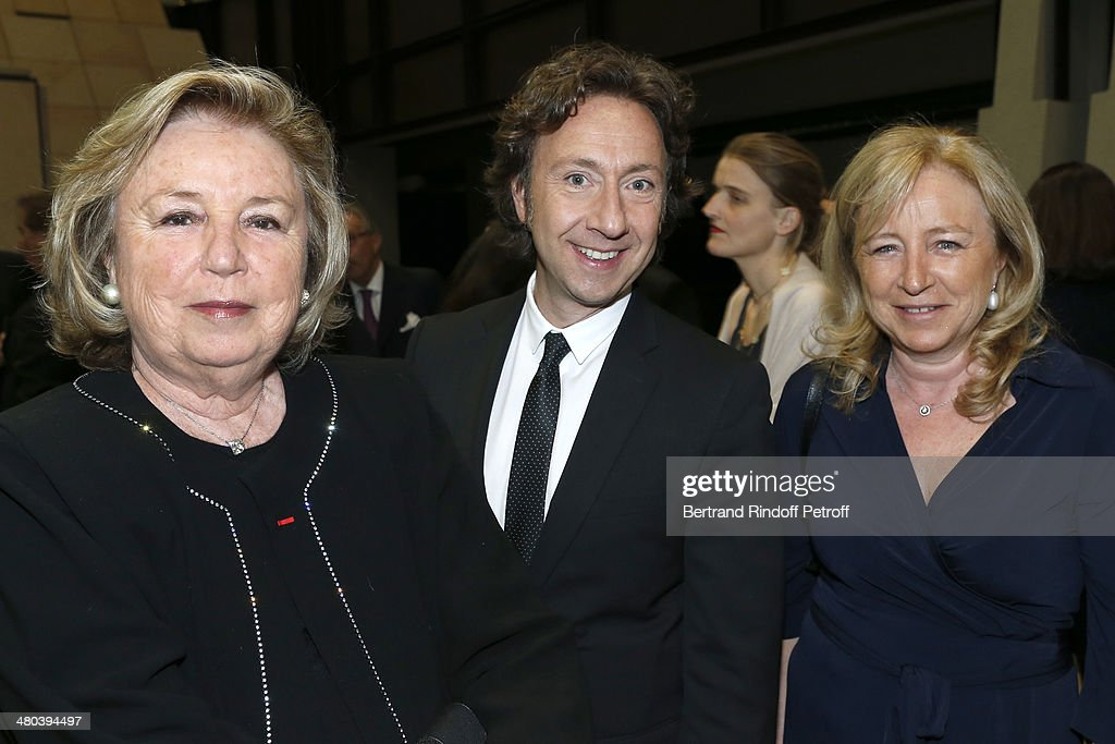 Madame Francois Pinault, author and journalist <a gi-track='captionPersonalityLinkClicked' href=/galleries/search?phrase=Stephane+Bern&family=editorial&specificpeople=2143398 ng-click='$event.stopPropagation()'>Stephane Bern</a> and Florence Rogers-Pinault attend the dinner party of the Societe Des Amis Du Musee D'Orsay (The Friends of Orsay Museum Society) at Musee d'Orsay on March 24, 2014 in Paris, France.