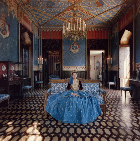 Madame Jean Serpieri sits in the ballroom of the Tour La Reine near Athens wearing a gown which belonged to the wife of Otto the first king of modern...