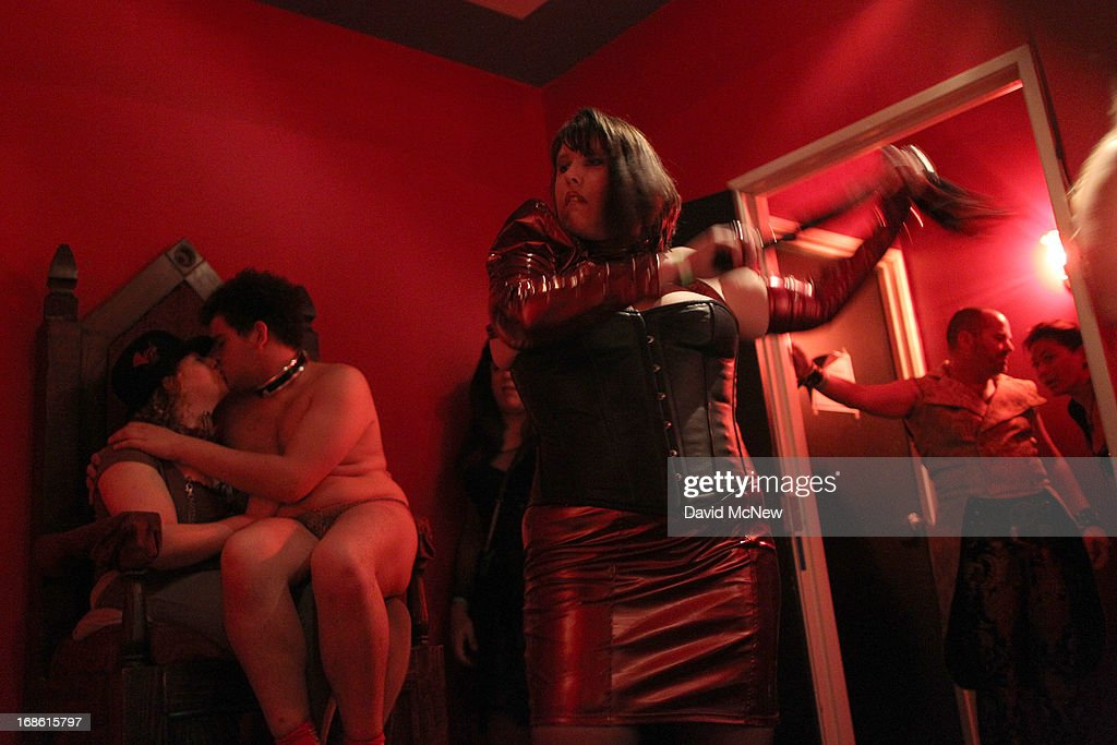 Madame Lynn whips a voluntarily submissive woman at a dungeon party during the domination convention, DomConLA, in the early morning hours of May 12, 2013 in Los Angeles, California. The annual convention was started in 2003 by fetish professional Mistress Cyan to bring together enthusiasts of BDSM (Bondage, Discipline, Submission and Dominance) and other fetishes.